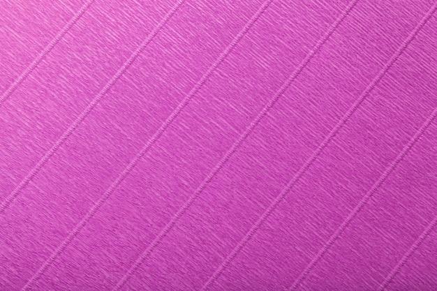 Estrutural do fundo roxo escuro de papel ondulado ondulado, close up. Foto Premium