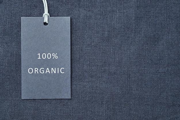 Etiqueta no fundo da tela de linho. 100% de matéria orgânica Foto Premium