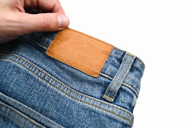 Etiqueta traseira em jeans, close-up. foto de alta qualidade Foto Premium