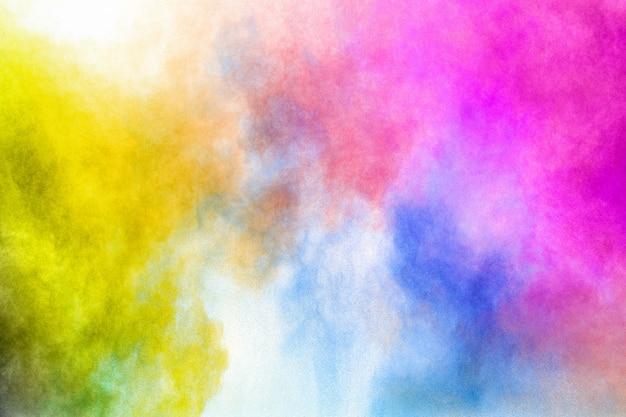 Explosão colorida para pó feliz holi. fundo de explosão de pó de cor. Foto Premium