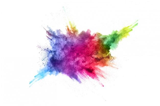 Explosão de pó colorido sobre fundo branco Foto Premium