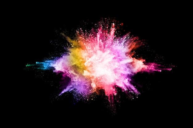 Explosão de pó colorido sobre fundo preto. Foto Premium