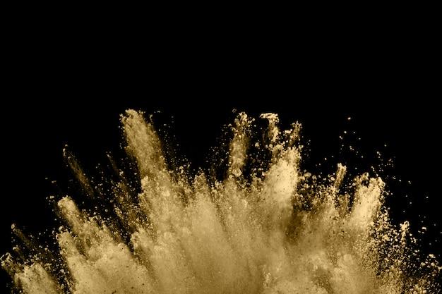 Explosão de pó dourado no preto. Foto Premium