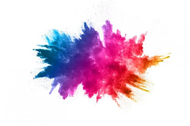 Explosão de pó multicolor em fundo branco Foto Premium