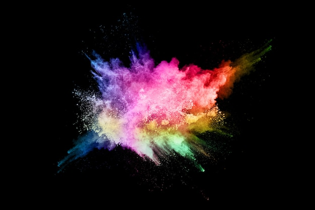 Explosão de poeira colorida abstrata sobre um fundo preto Foto Premium