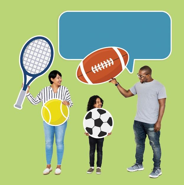 Família feliz com ícones do esporte Foto Premium