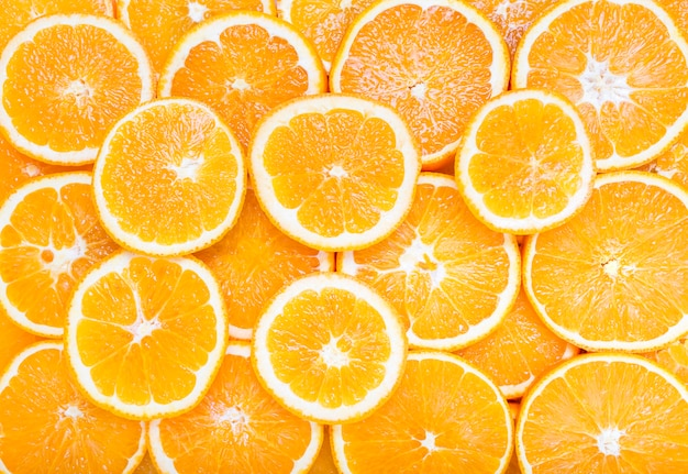 Fatias de fundo de frutas cítricas laranja Foto Premium