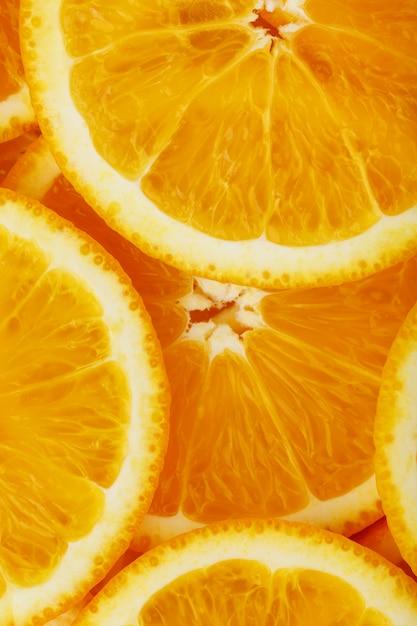Fatias de laranja redondas, sob a forma de textura e lanternas de fatias suculentas frescas Foto Premium