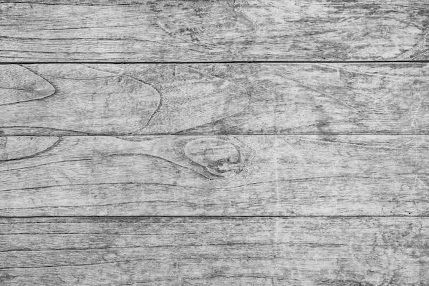 Feche acima da tabela de madeira rústica com textura de superfície da grão no fundo do estilo do vintage. Foto Premium