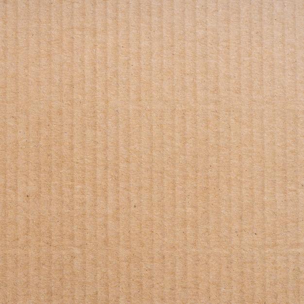 Feche acima da textura e do fundo marrons da caixa de papel do cartão. Foto Premium