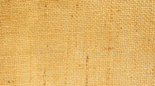 Feche acima de um saco marrom para um fundo abstrato. Foto Premium