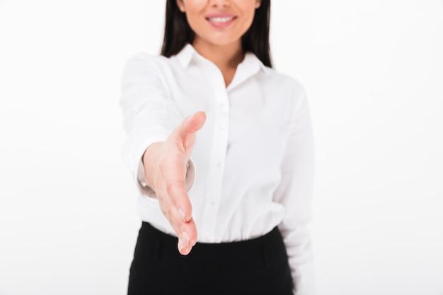 Feche acima de uma mulher de negócios asiática amigável Foto gratuita