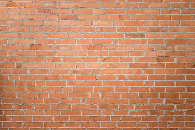 Feche acima do fundo da parede de tijolo Foto gratuita