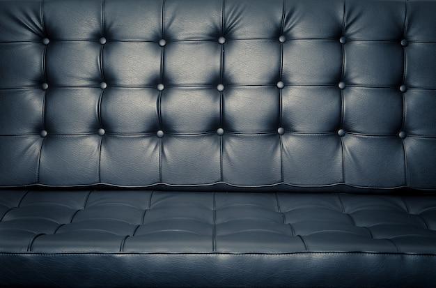 Feche acima do sofá de couro para o fundo Foto Premium