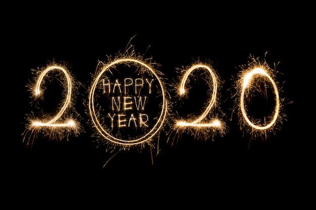 Feliz ano novo 2020. texto criativo feliz ano novo 2020 escrito estrelinhas isoladas Foto Premium