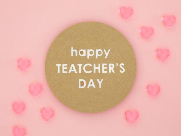Feliz dia do professor corações rosa Foto gratuita