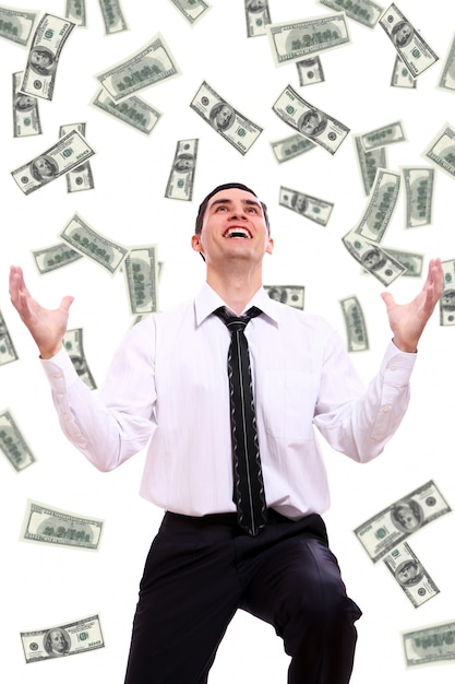 Feliz empresário e notas de dólar voador Foto gratuita