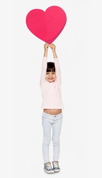 Feliz, menina, segurando, um, coração, ícone Foto Premium