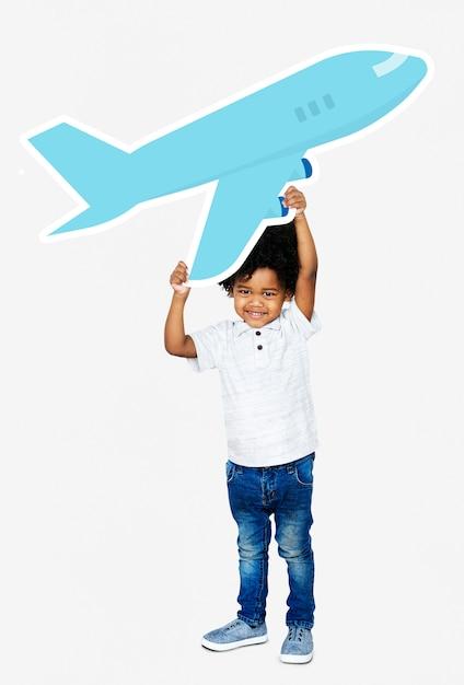 Feliz, menino, segurando, um, avião, ícone Foto Premium