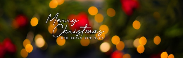 Feliz natal e feliz ano novo. banner de fundo de bokeh de luz de natal Foto Premium