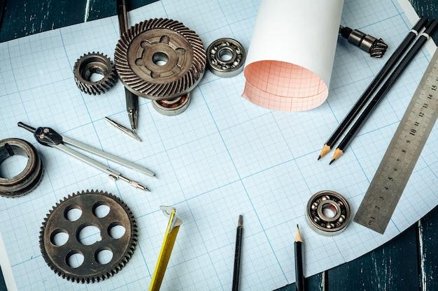 Ferramentas de engenharia de carro vista superior em papel milimetrado Foto Premium