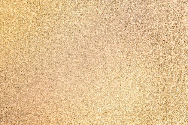 Fim, cima, de, brilho dourado, textured, fundo Foto gratuita