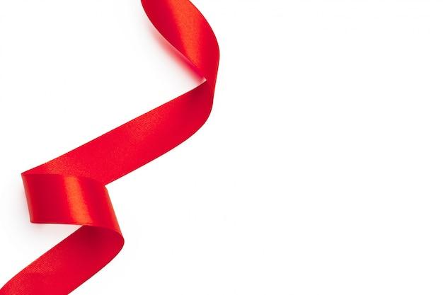 Fita vermelha em fundo branco Foto Premium