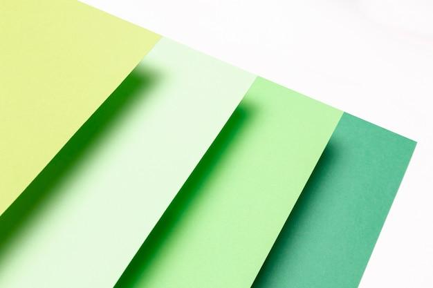 Flat lay diferentes tons de padrões verdes close-up Foto gratuita