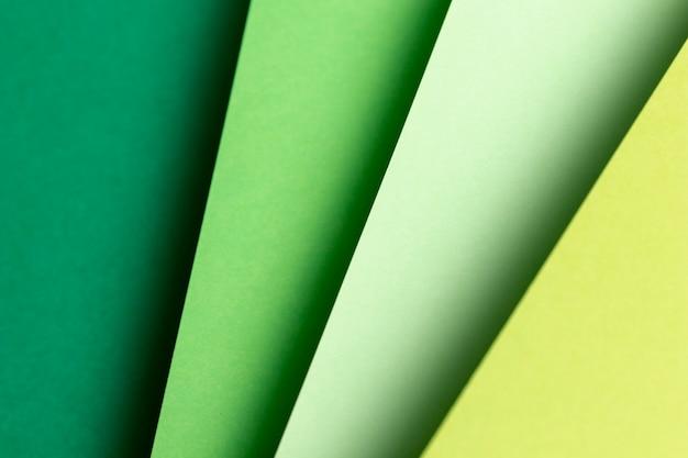 Flat leigos diferentes tons de papéis verdes Foto gratuita