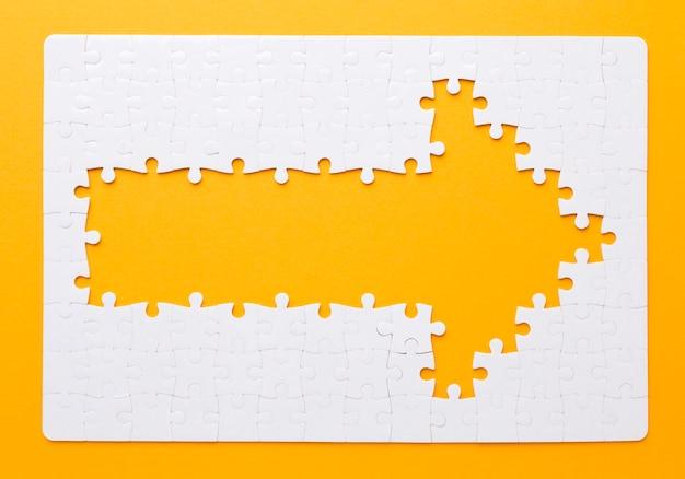 Flecha feita de peças de quebra-cabeça, apontando para a direita Foto Premium