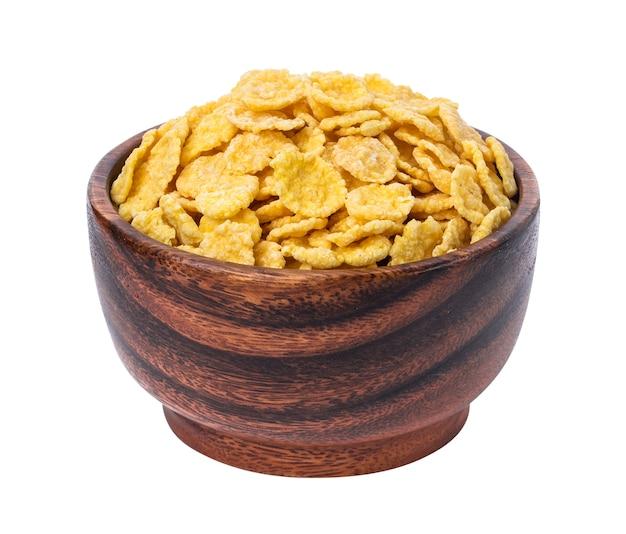 Flocos de milho em uma tigela de madeira, isolado no branco Foto Premium