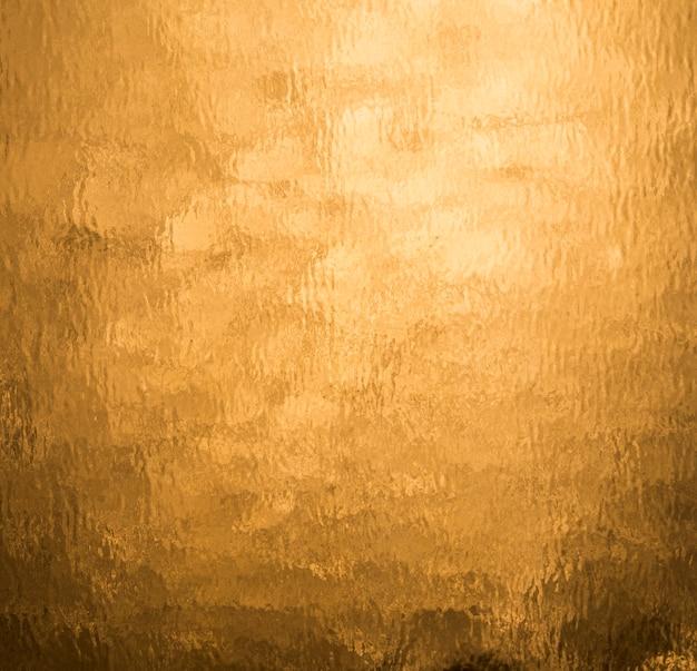 Folha de laranja de fundo dourado Foto Premium