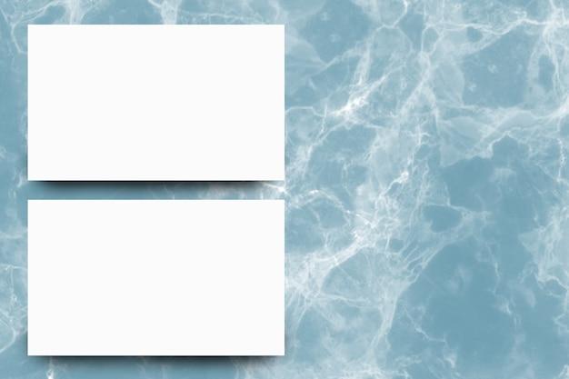 Folha de papel branco vazio sobre fundo de mármore índigo Foto Premium