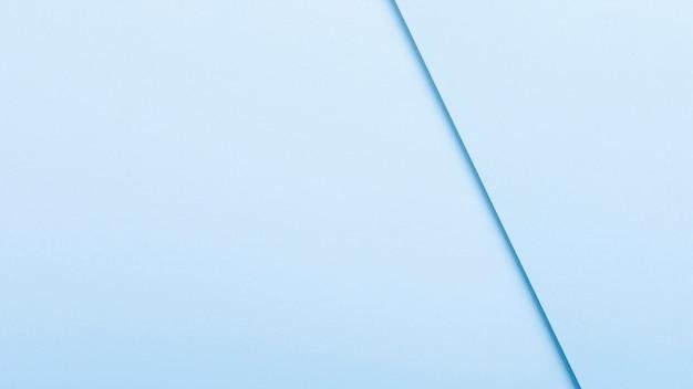 Folhas de papel tonificado azul com espaço de cópia Foto gratuita
