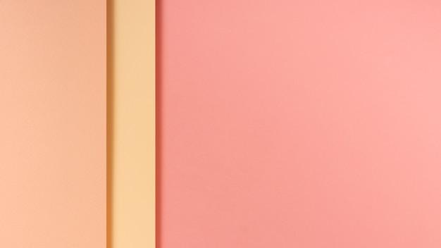 Folhas de papel tonificado rosa com espaço de cópia Foto gratuita