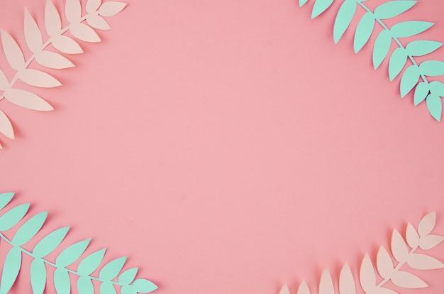 Folhas tropicais em estilo de corte de papel rosa e azul Foto Premium