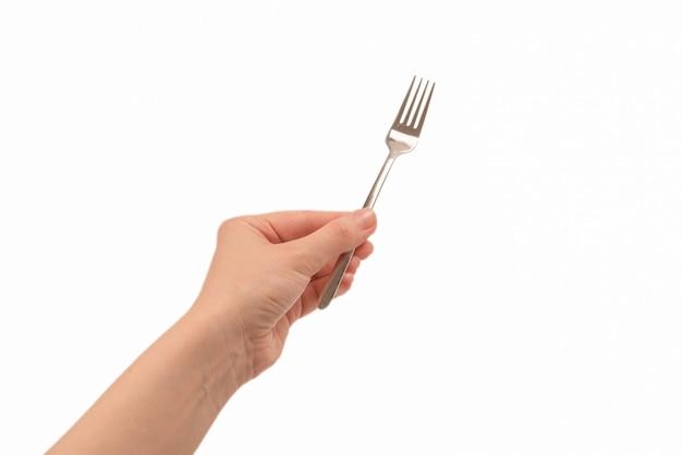 Forquilha na mão da mulher isolada no branco. Foto Premium