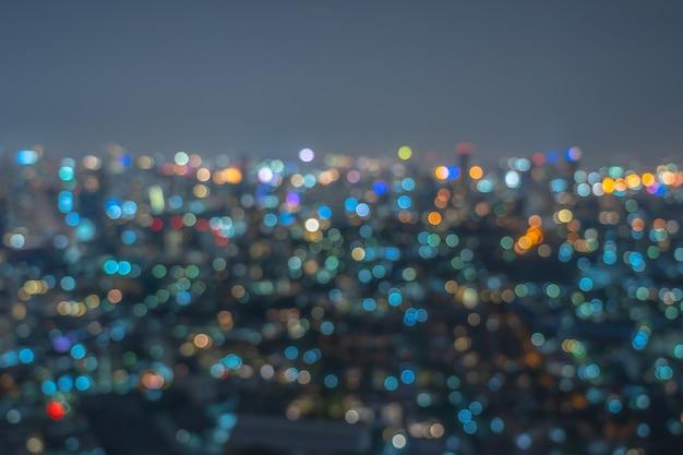 Foto abstrata turva bokeh da paisagem urbana de banguecoque na hora do crepúsculo, conceito de plano de fundo Foto Premium