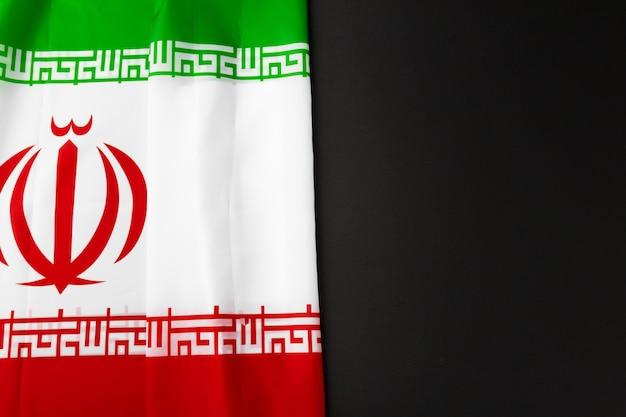 Foto da bandeira de tecido do irã, close-up Foto Premium