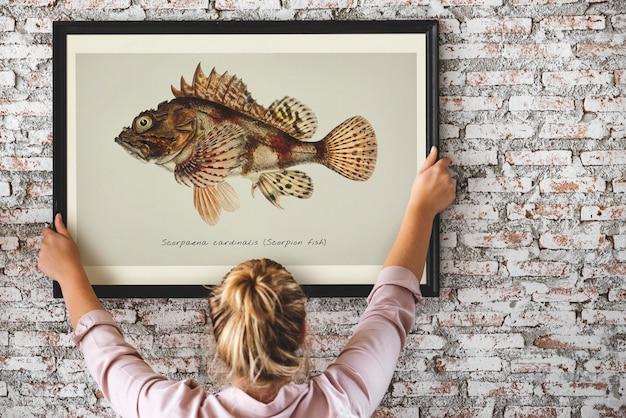 Foto, de, mão, desenho, peixe, em, um, quadro Foto Premium