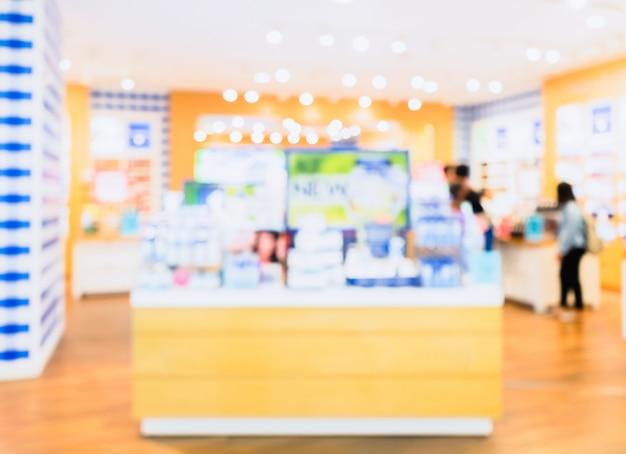 Foto desfocada abstrata de balcão de loja de cosméticos com bokeh de fundo Foto Premium