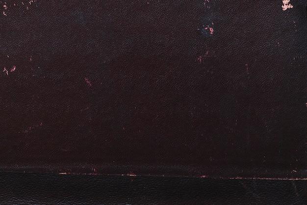 Foto macro de uma textura de capa de livro preto velho Foto gratuita
