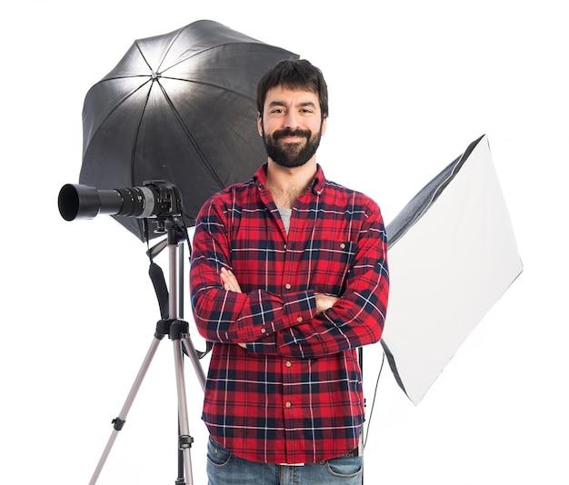 Fotógrafo em seu estúdio Foto gratuita