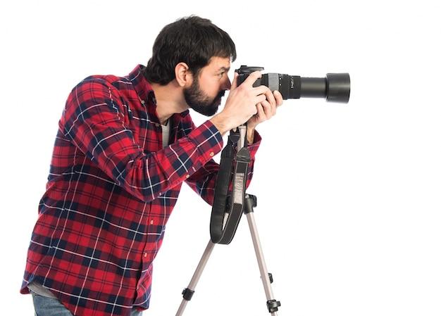 Fotógrafo tomando uma foto Foto gratuita
