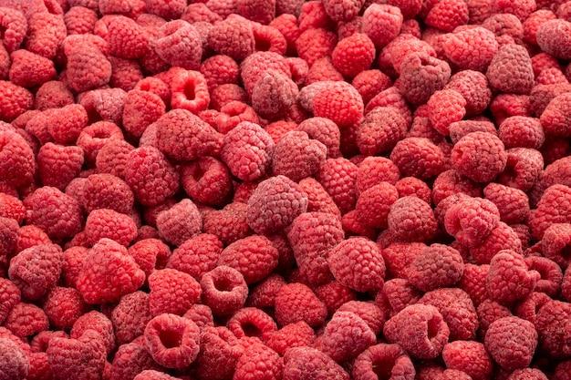 Framboesa fresca congelada. fundo de alimentos de frutas. Foto Premium