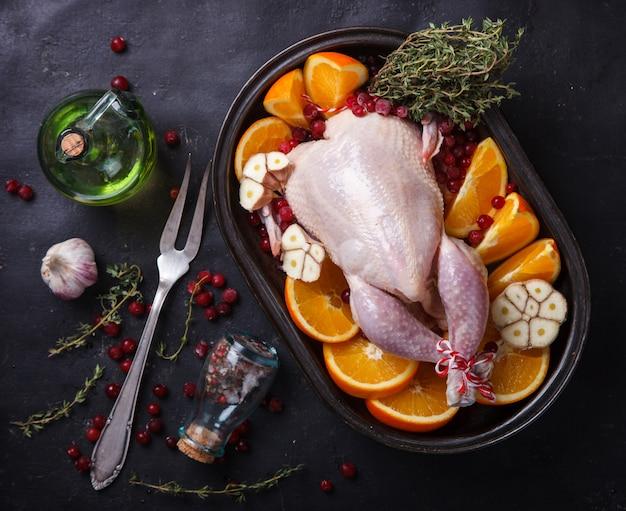 Frango assado com laranjas Foto Premium