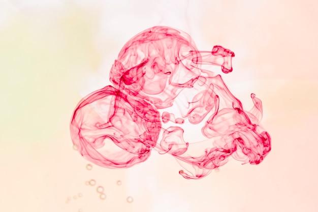 Fumaça monocromática abstrata em rosa Foto gratuita