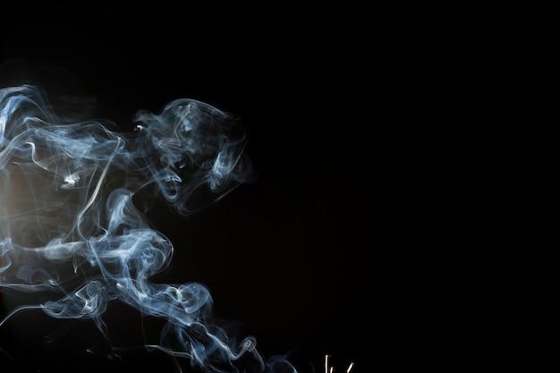 Fumo ou vapor no preto, resumo Foto Premium