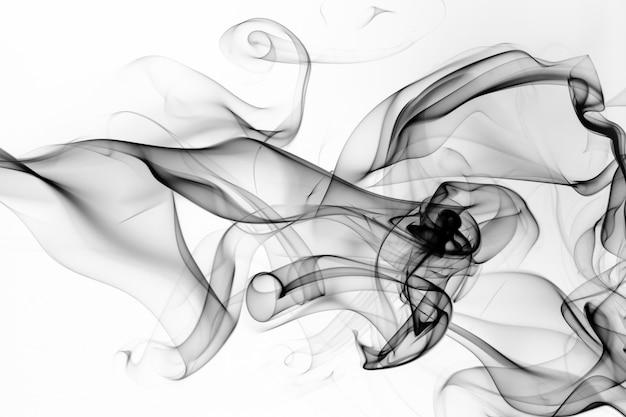 Fumo preto no fundo branco. projeto de fogo Foto Premium