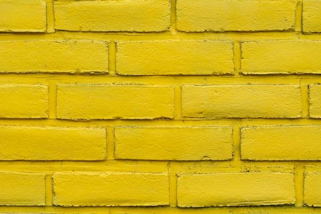 Fundo abstrato amarelo da parede de tijolo Foto gratuita